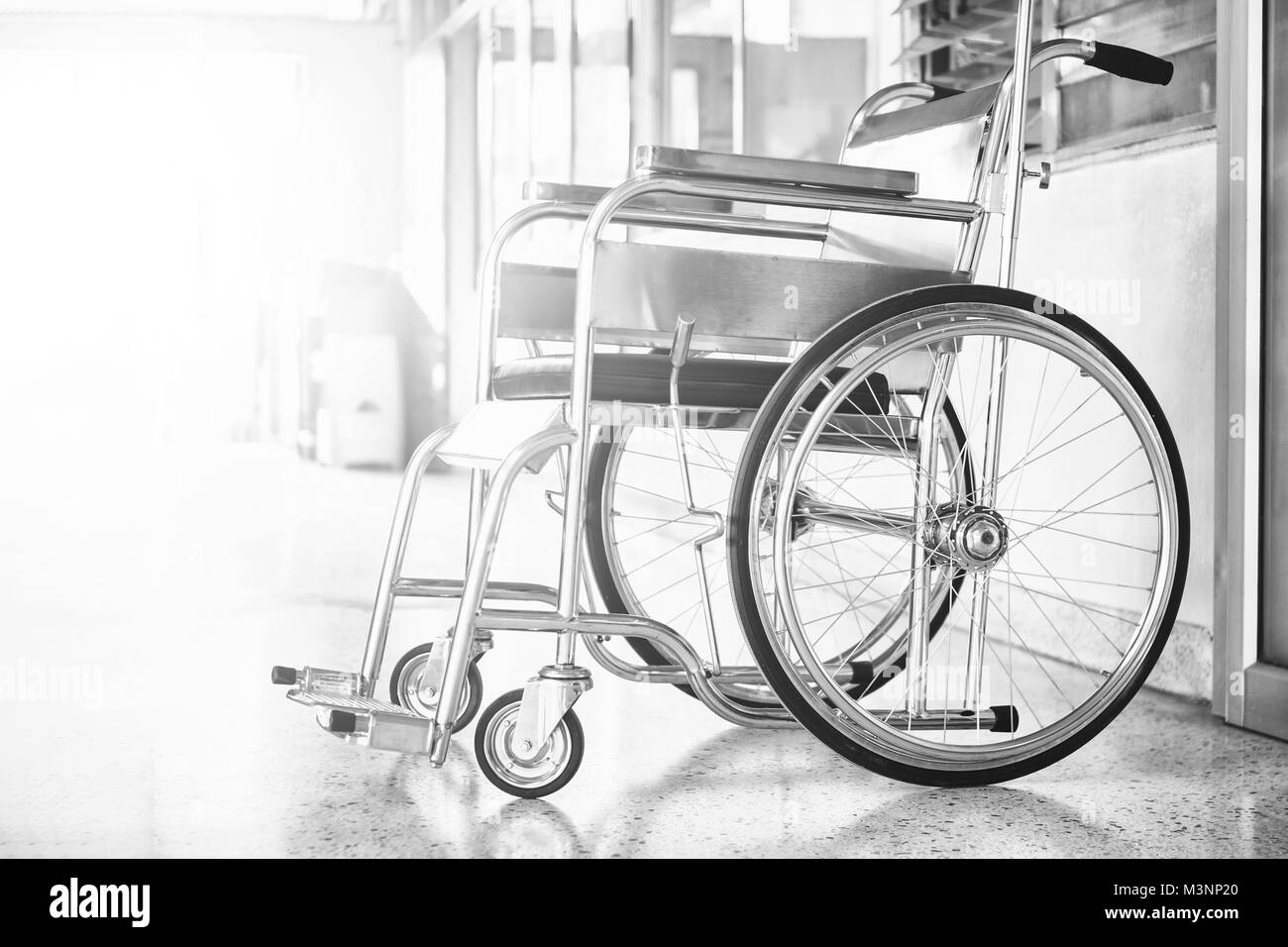 Wheelchairs in the hospital ,Wheelchairs waiting for patient services. with light copy space on left area - Stock Image
