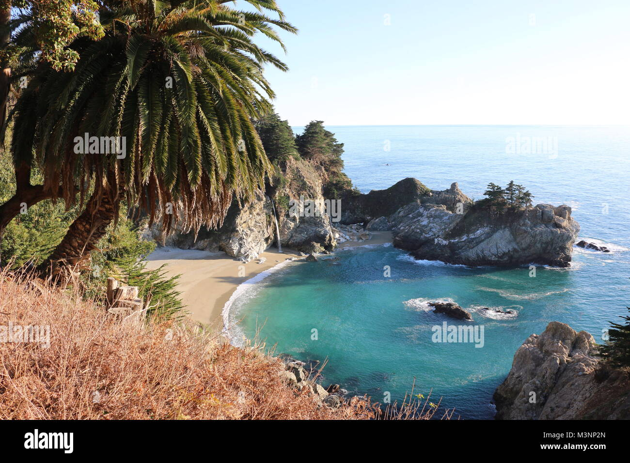 McWay Falls, a beautiful waterfall, plunges into the sand at Julia Pfeiffer Burns State Park, Big Sur, CA. - Stock Image