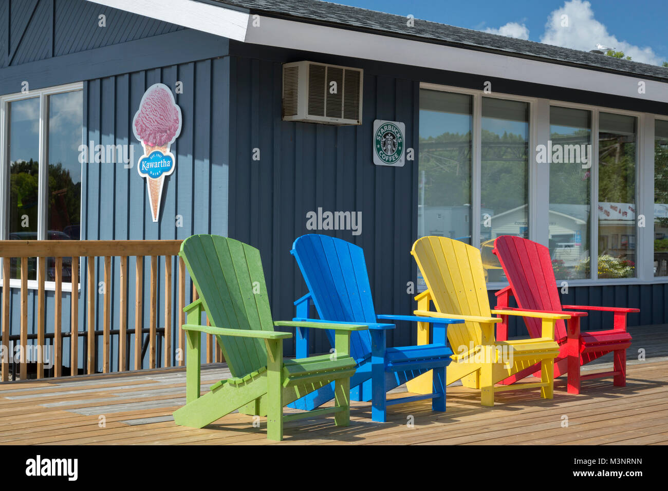 Bright Color Adirondack Chairs On Outside Wood Deck Concession Store