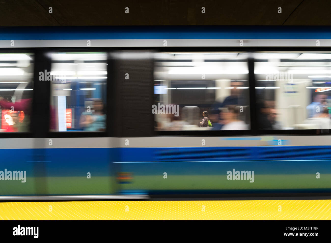 Motion blur: Montreal subway wagon departing from a station. - Stock Image