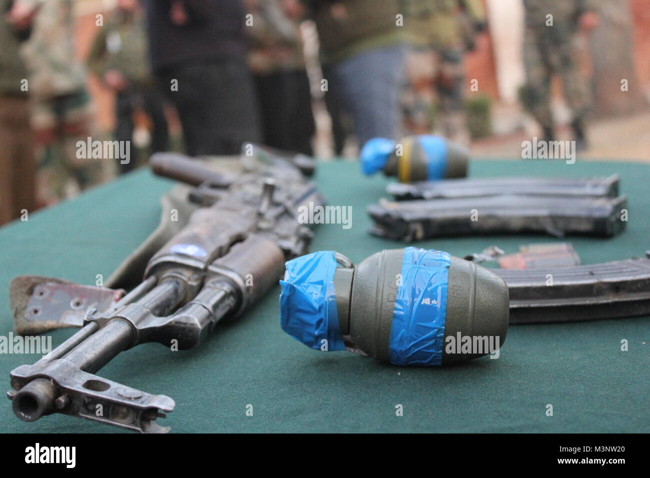 automatic rifle and teargas shell, Sopore town, Kashmir, India, Asia - Stock Image