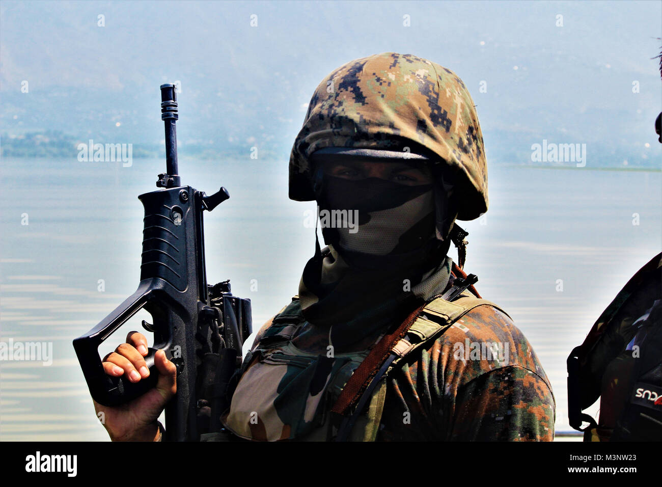 Army man with automatic rifle, Sopore town, Kashmir, India, Asia - Stock Image