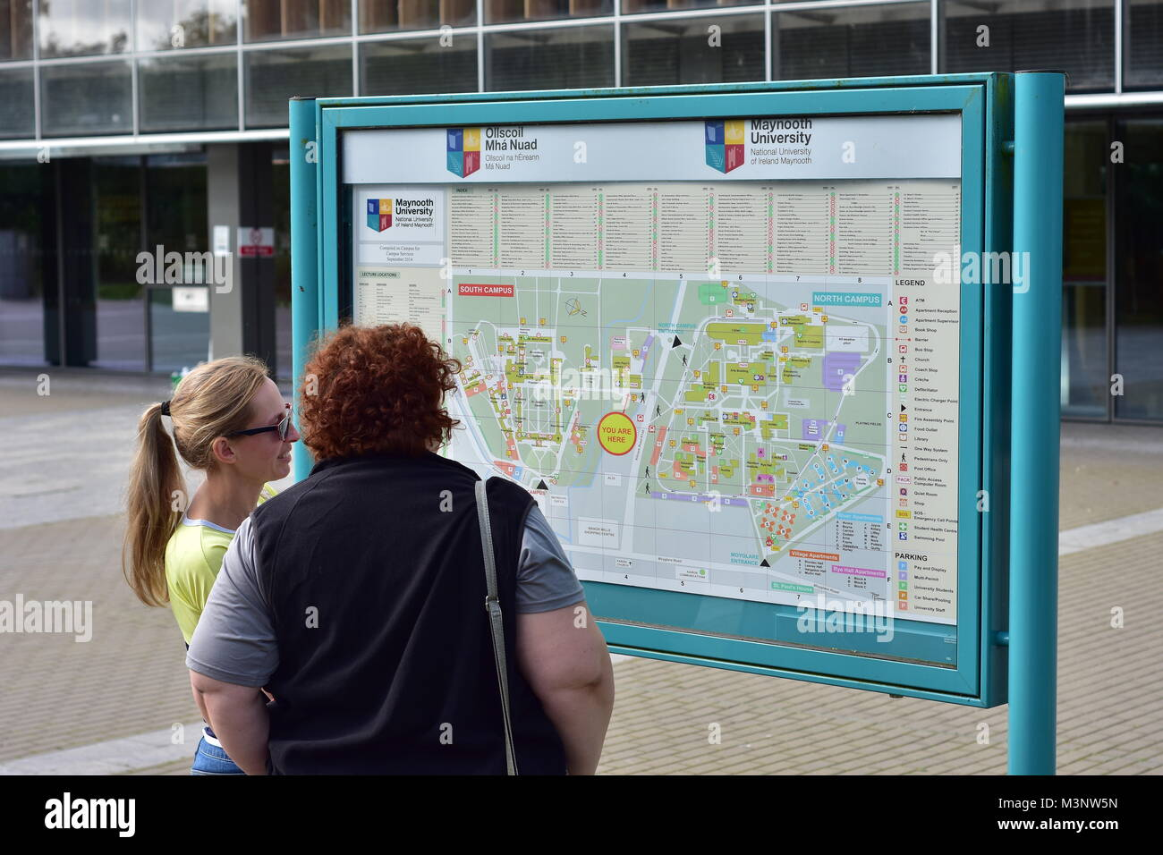 Visitors at campus site map of Maynooth University in town of Maynooth in Ireland. - Stock Image