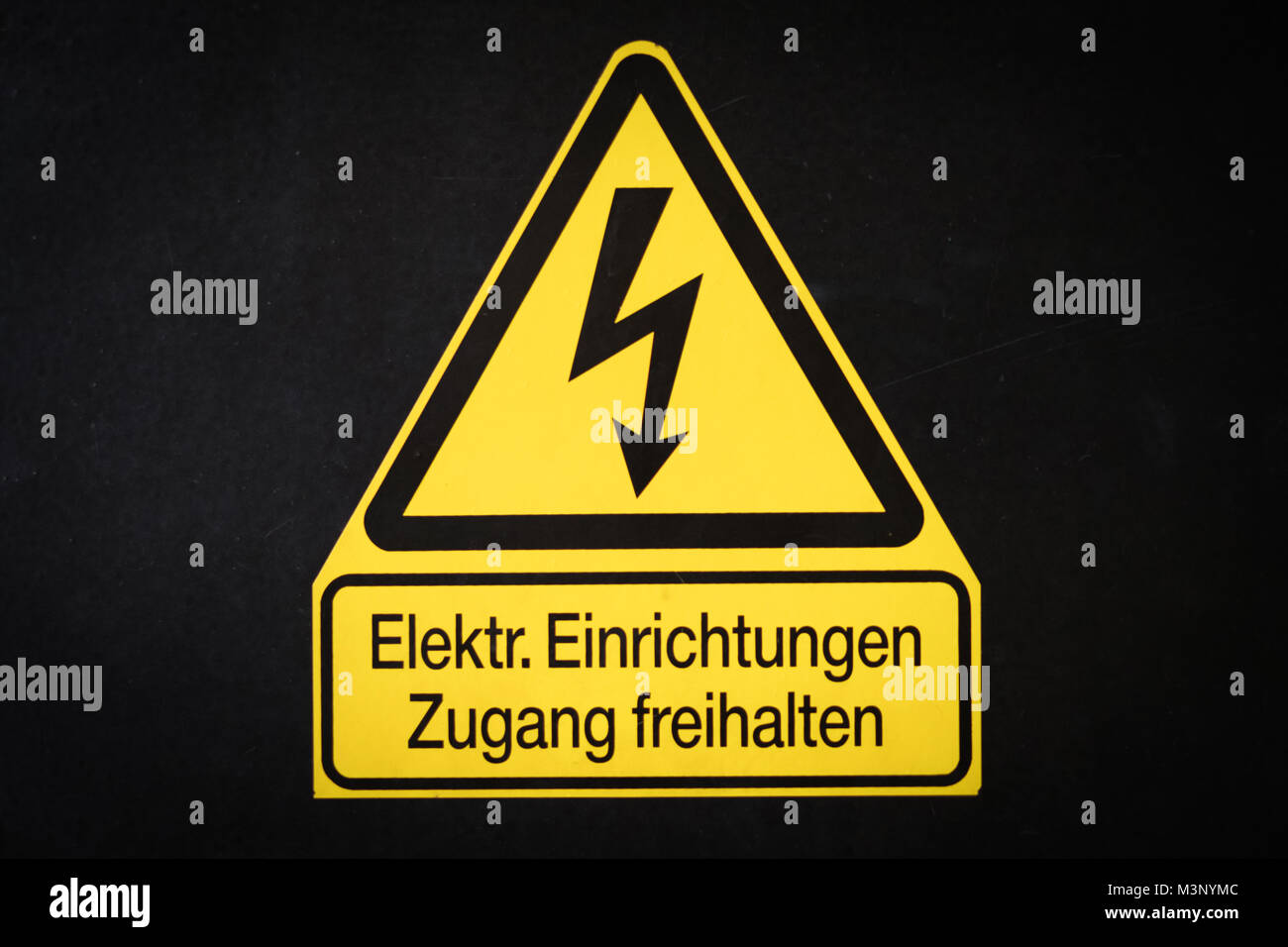 Elctricity warning sign with flash symbol (german: Elektrische Stock ...