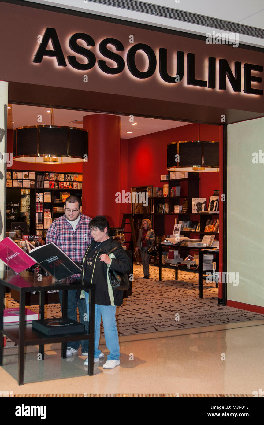 Las Vegas, Nevada.  Customers check out the Assouline luxury bookstore display in the Crystals at City Center Shopping - Stock Image