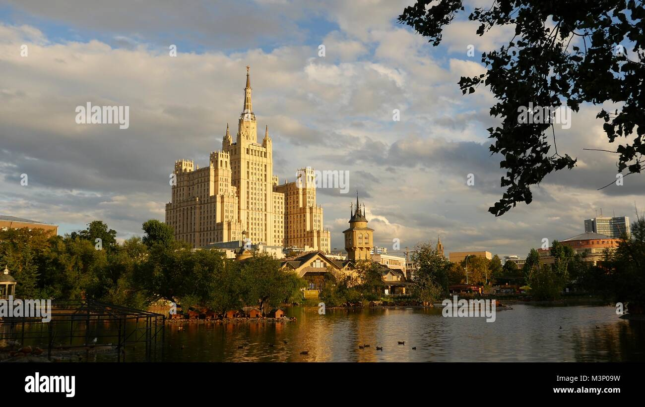 Kudrinskaya Square Building is one of seven Stalinist skyscrapers. Against the backdrop  the lake. Evening. - Stock Image