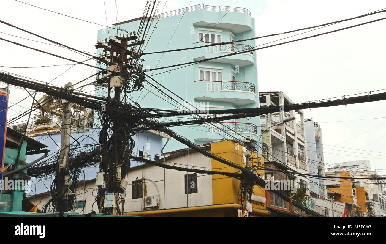 The web of power lines on the streets Ho Chi Minh City 2 - Stock Image