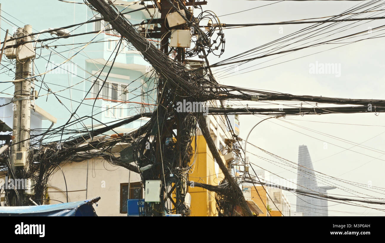 The web of power lines on the streets Ho Chi Minh City 3 - Stock Image