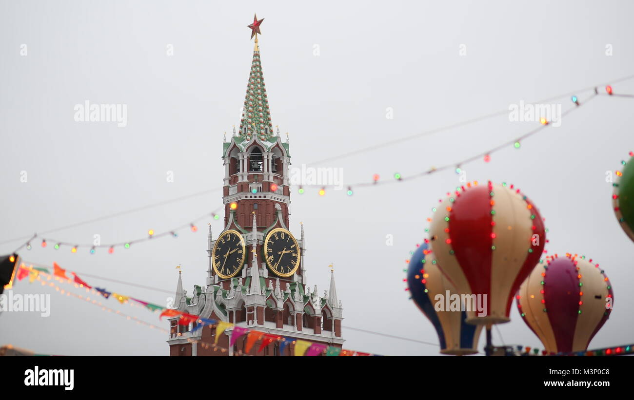 Moscow. Christmas. Entertaining attractions at the Kremlin. People in the booths are attracted by balloons. New - Stock Image