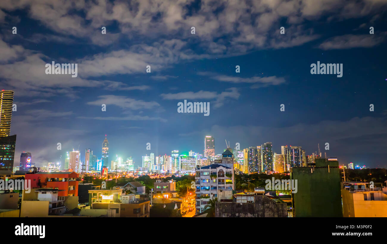 Time lapse view of Makati skyscrapers in Manila city. Skyline at night, Philippines. - Stock Image
