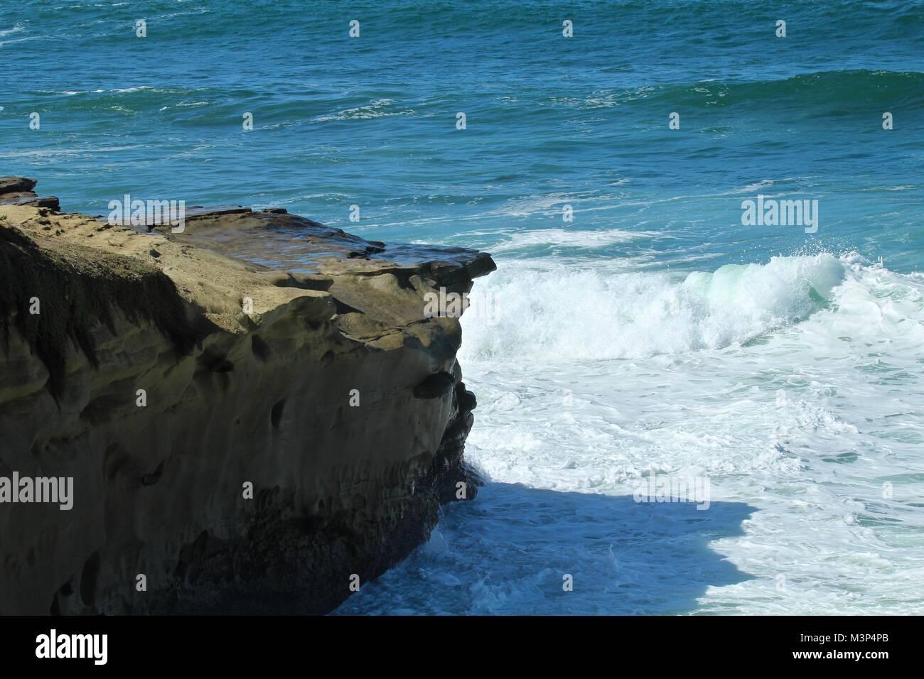waves crashing on cliffs in La Jolla California - Stock Image