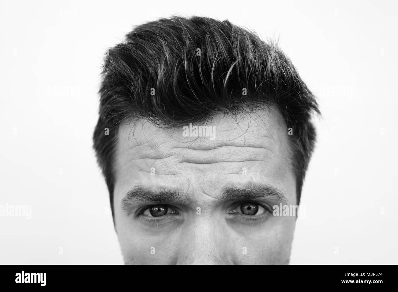 half face portrait of caucasian man with serious depression in monochrome black and white style. - Stock Image
