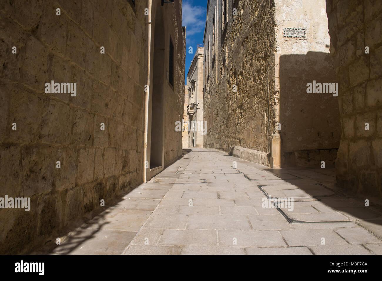 Enjoying a walkin a quite historical road in Mdina, Malta. - Stock Image