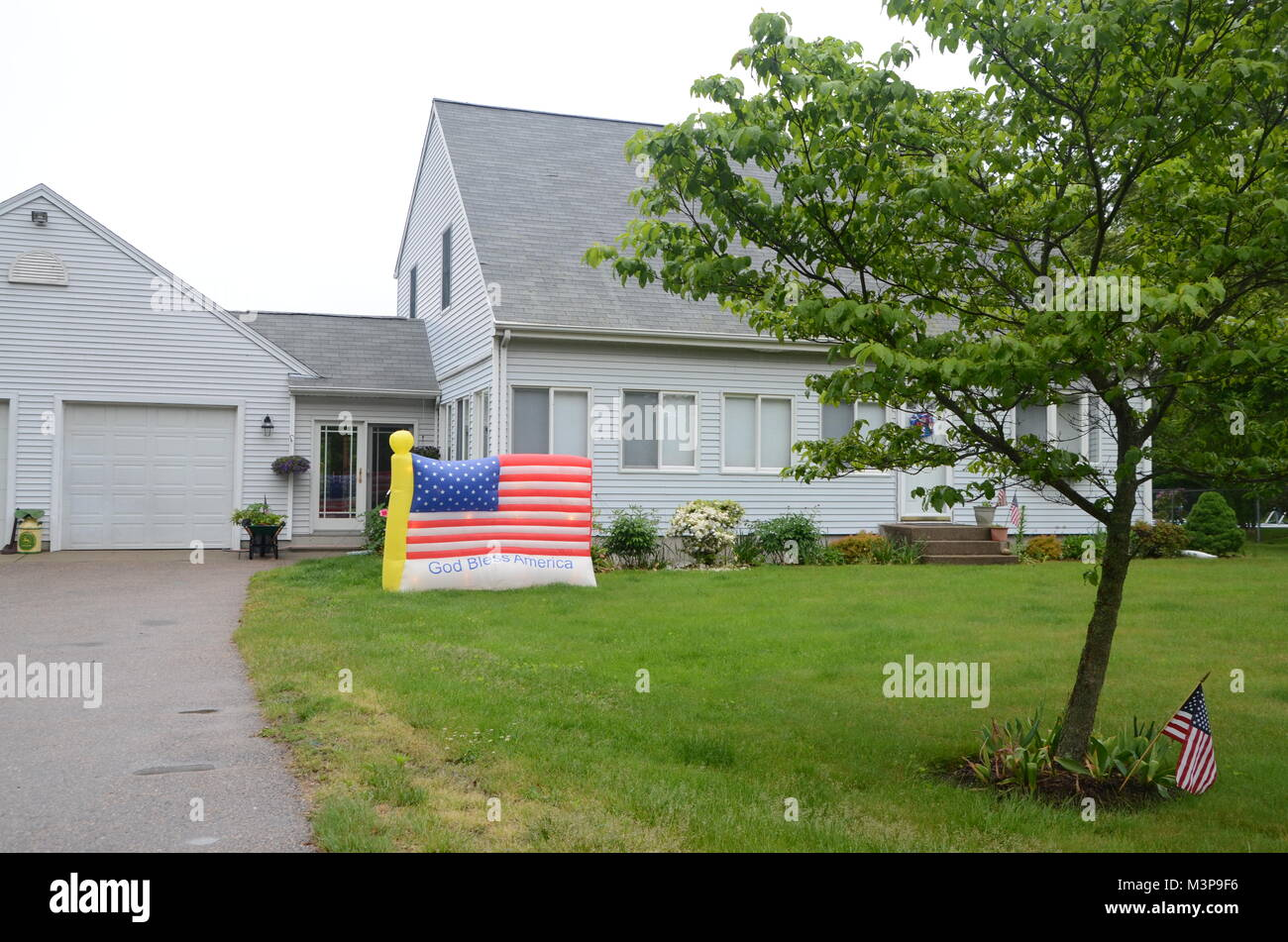 inflatable stats and stripes on a lawn wakefield south kinstown rhode island USA - Stock Image