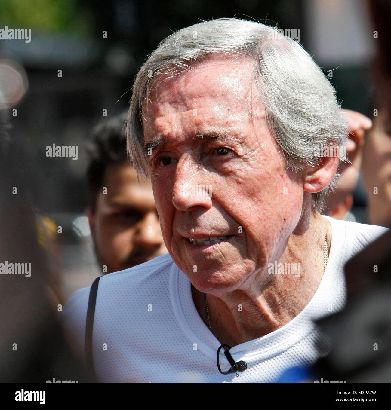 25/07/2012. London, U.K.  Gordon Banks, ex England goalkeeper, takes the torch down Wembley Way. The Olympic torch - Stock Image