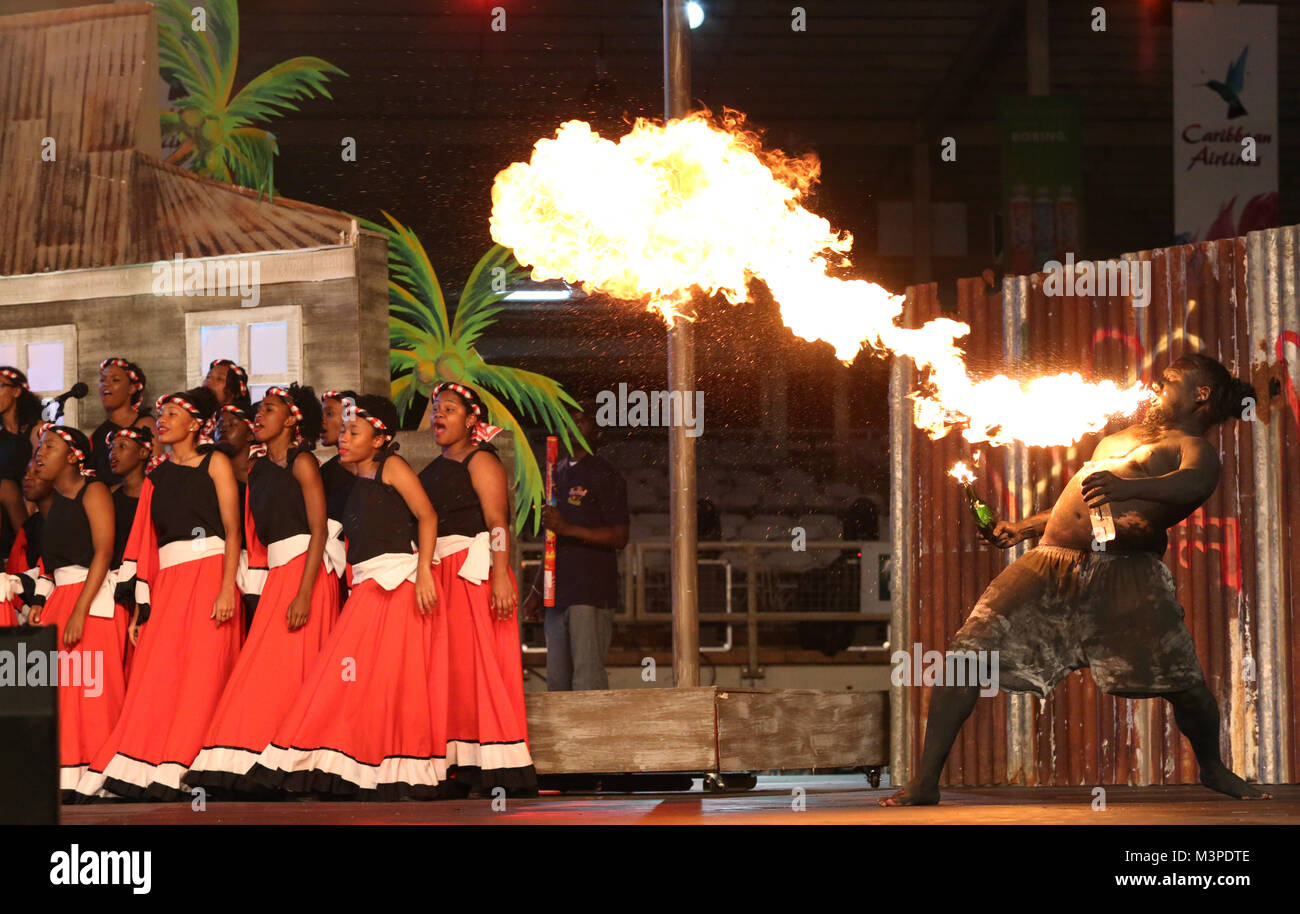 Trinidad, Port of Spain. 11th Feb, 2018. Singers and a  traditional mas character during a performance​ at the Dimanche - Stock Image