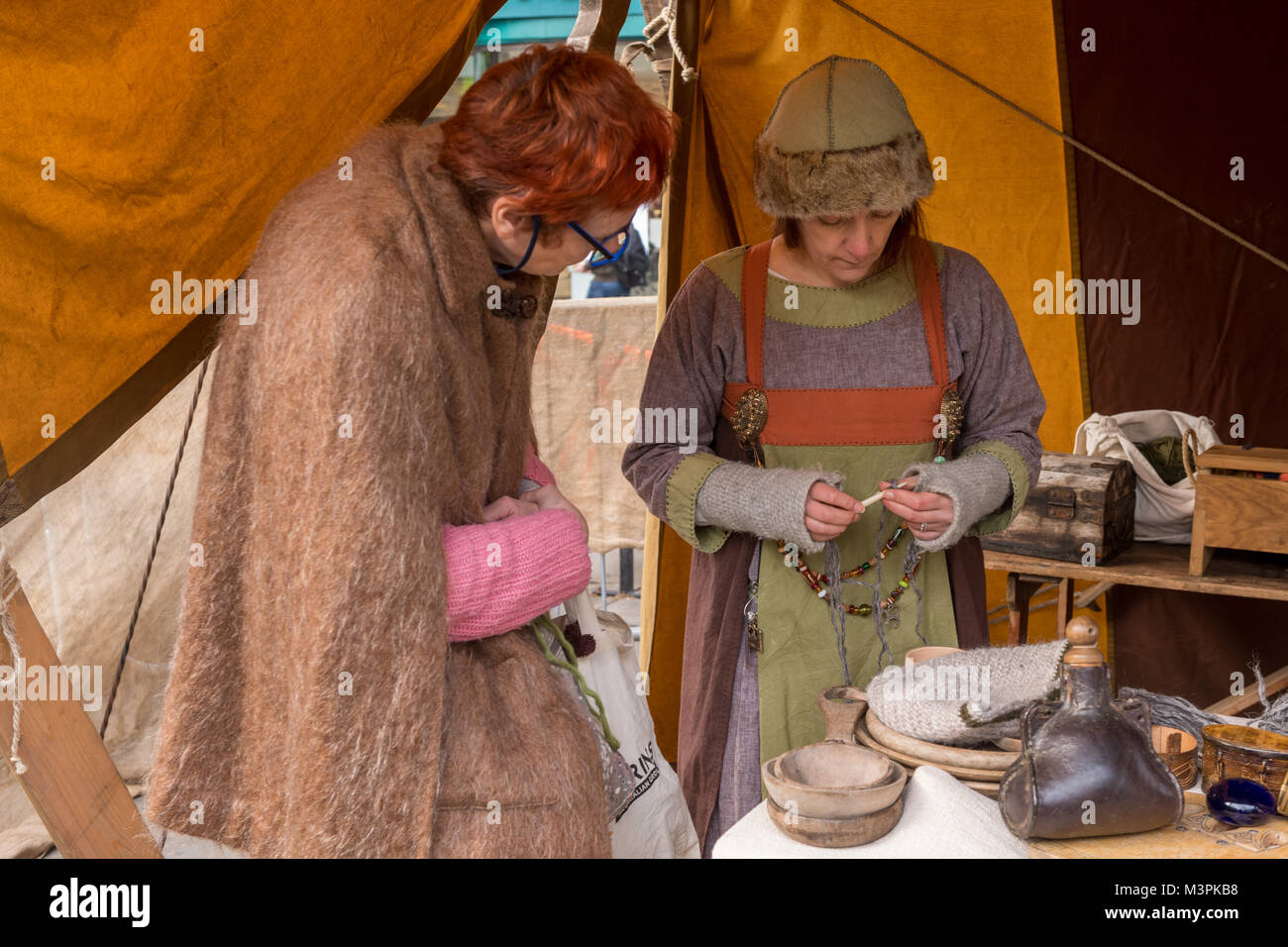 York, UK, 12th February 2018, Two women together, one dressed as a Viking, at the annual Jorvik Viking Festival. - Stock Image