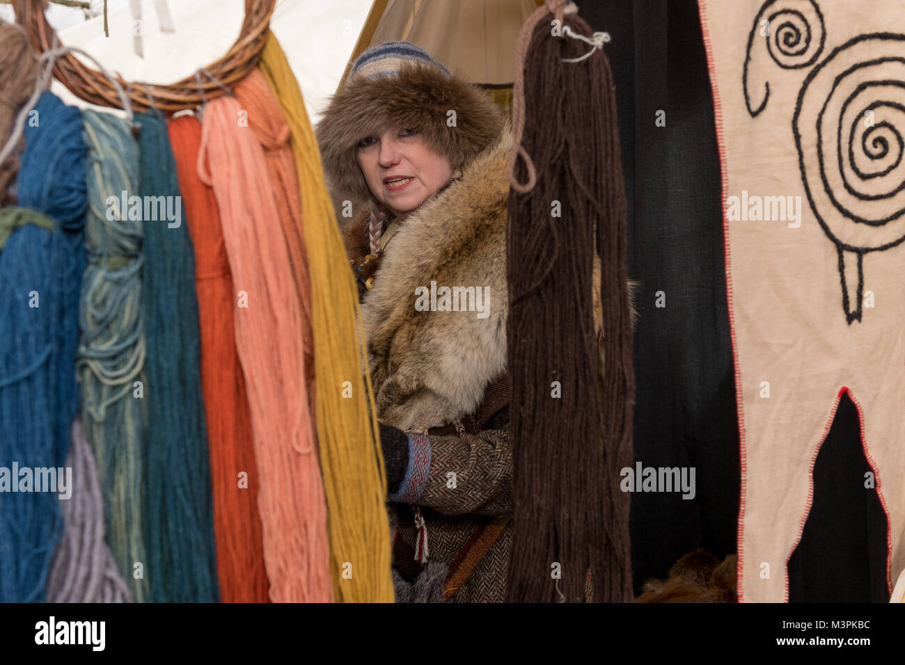 York, UK, 12th February 2018, Lady dressed as a Viking at the annual Jorvik Viking Festival. Standing by a market - Stock Image
