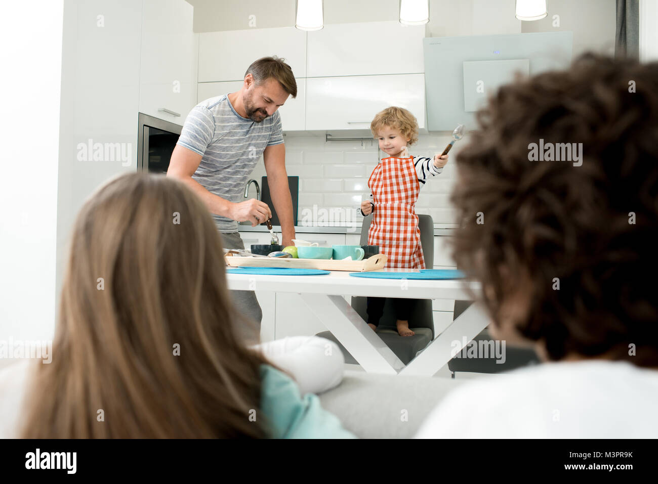 Father and Son Cooking Together - Stock Image