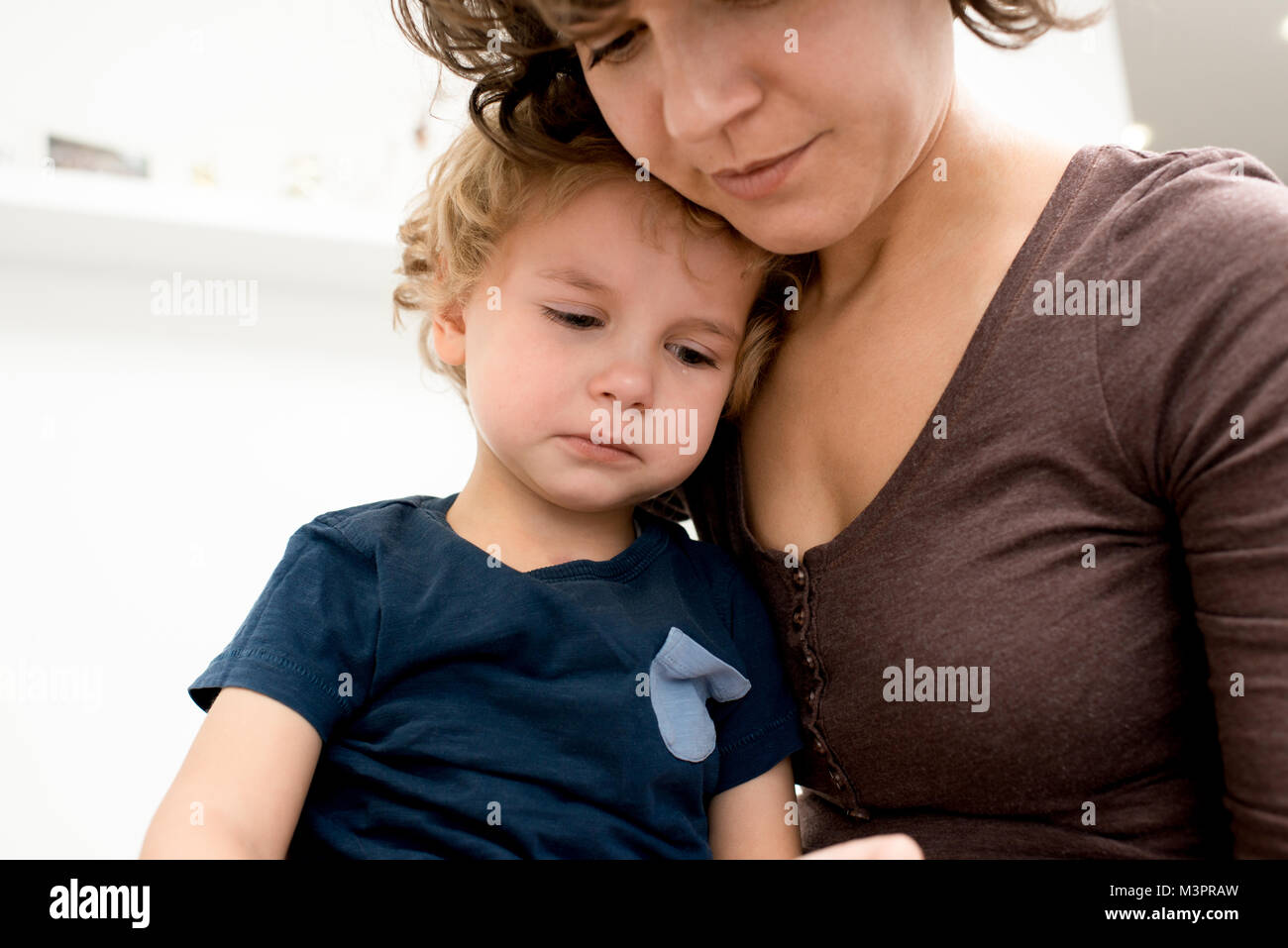 Mother Calming Crying Son - Stock Image