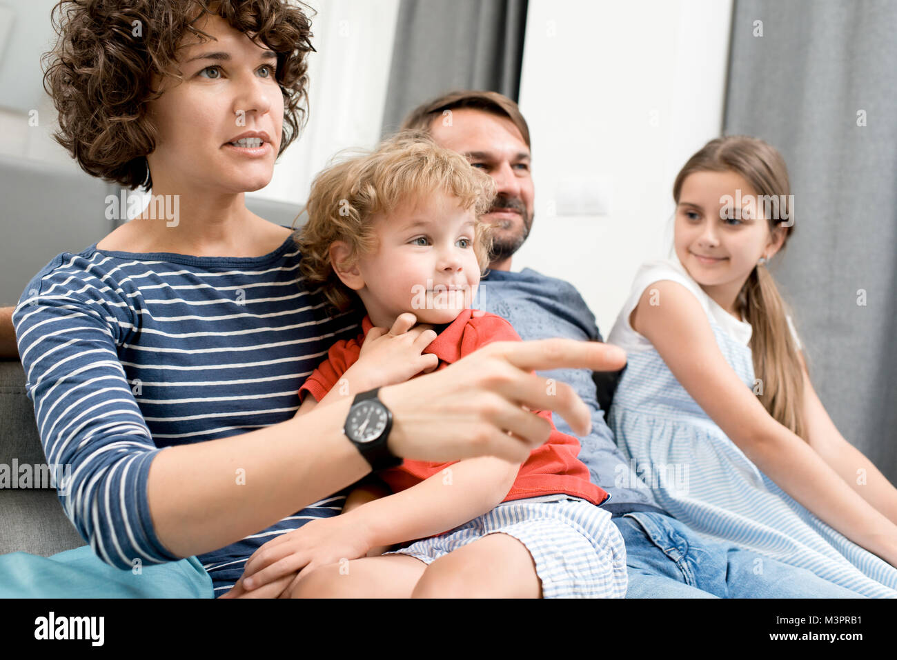 Family Watching TV - Stock Image