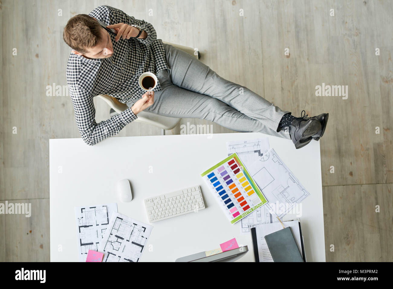 Designer Relaxing at Workplace - Stock Image