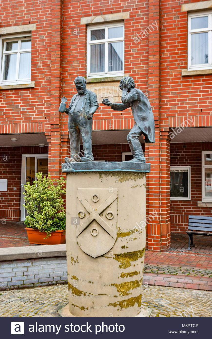Statue in front of the Rathaus — city hall — in Ankum, Niedersachsen (Lower Saxony), Germany - Stock Image