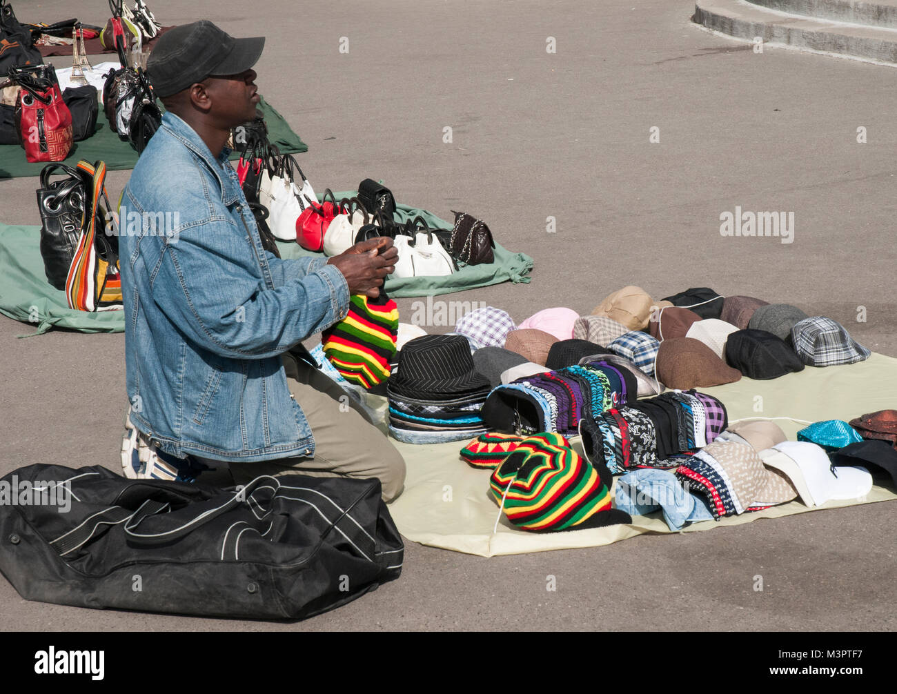 African immigrant pavement vendor in Montmartre, Paris - Stock Image
