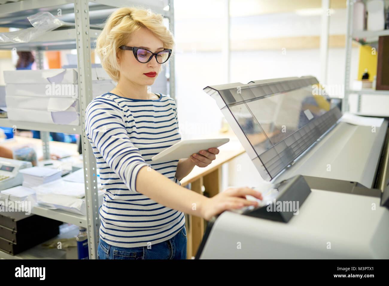 Modern Woman Using Plotter - Stock Image