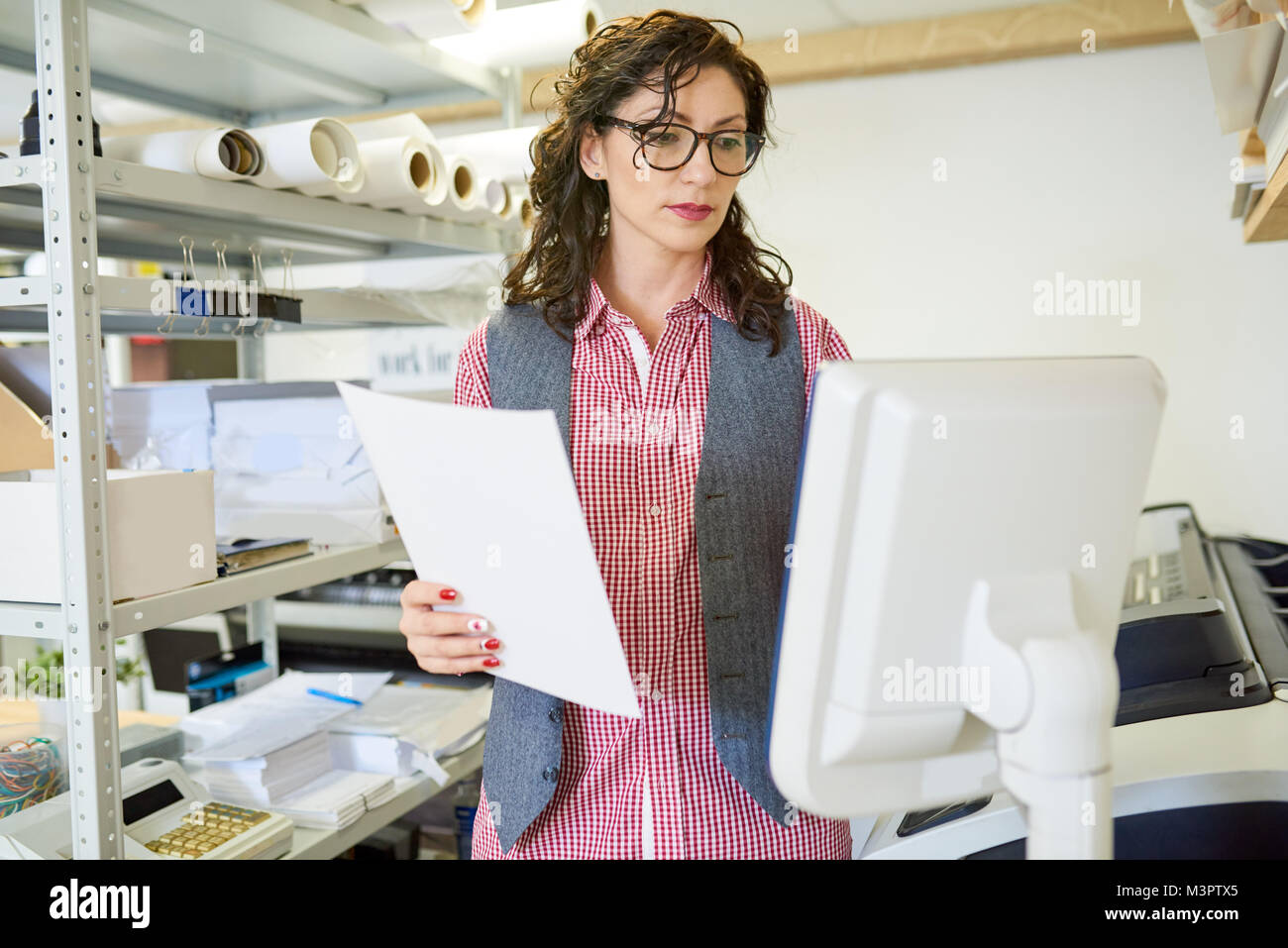 Manager Operating Printing Press - Stock Image