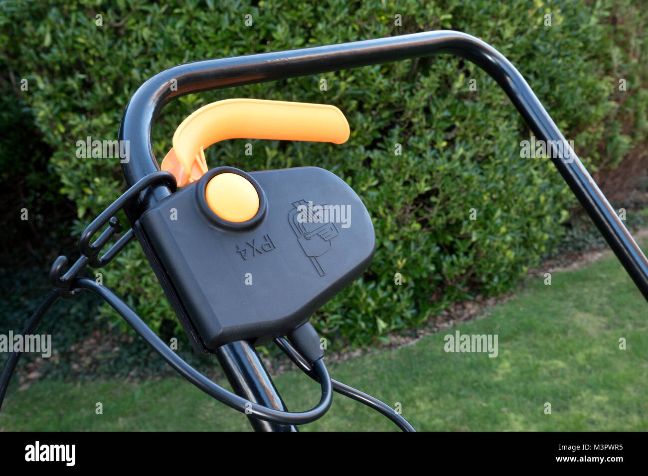 Safety switch on electrical garden power mower - Stock Image