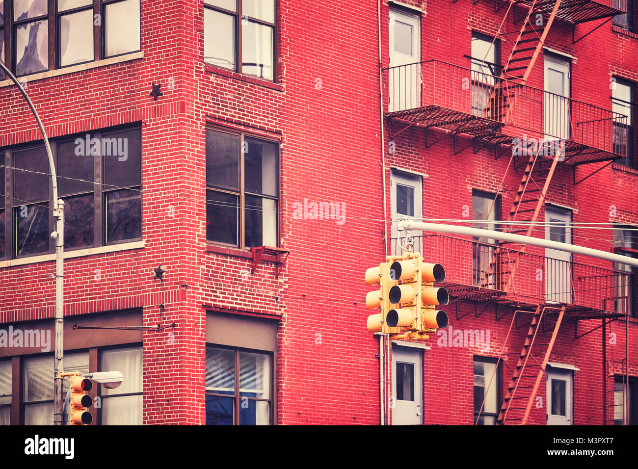 New York City traffic lights with building on background , color toned picture, USA. Stock Photo