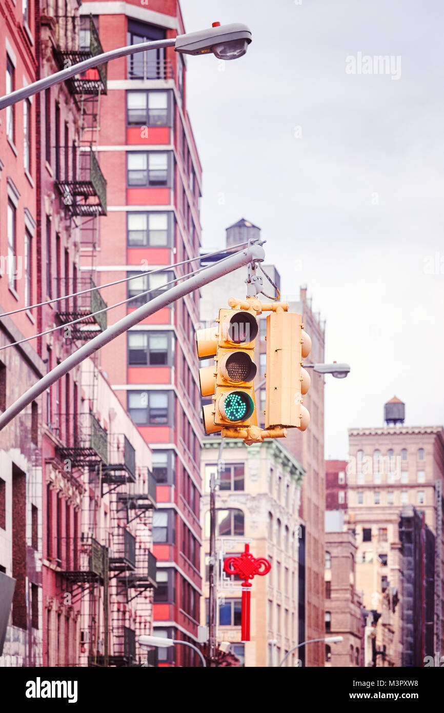 New York City traffic lights with buildings on background , color toned picture, USA. - Stock Image
