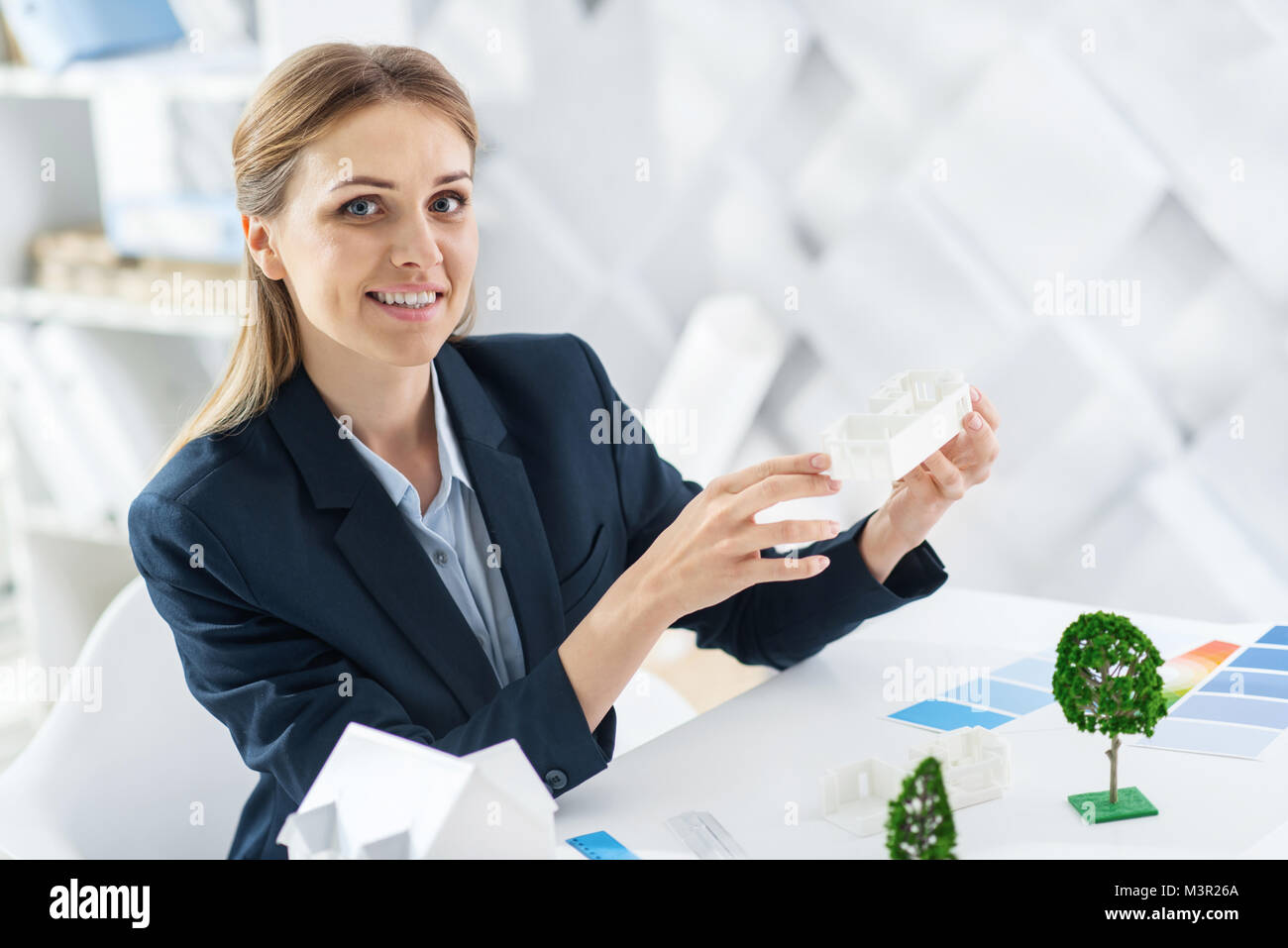 Inspired engineer holding the models of the house - Stock Image