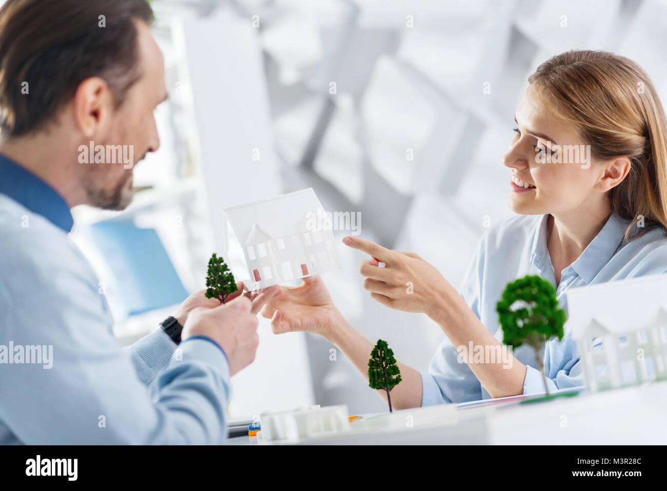 Delighted landscape designers working together - Stock Image