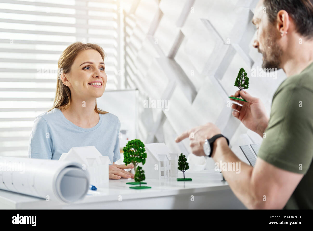 Inspired ecologist working with her colleague - Stock Image