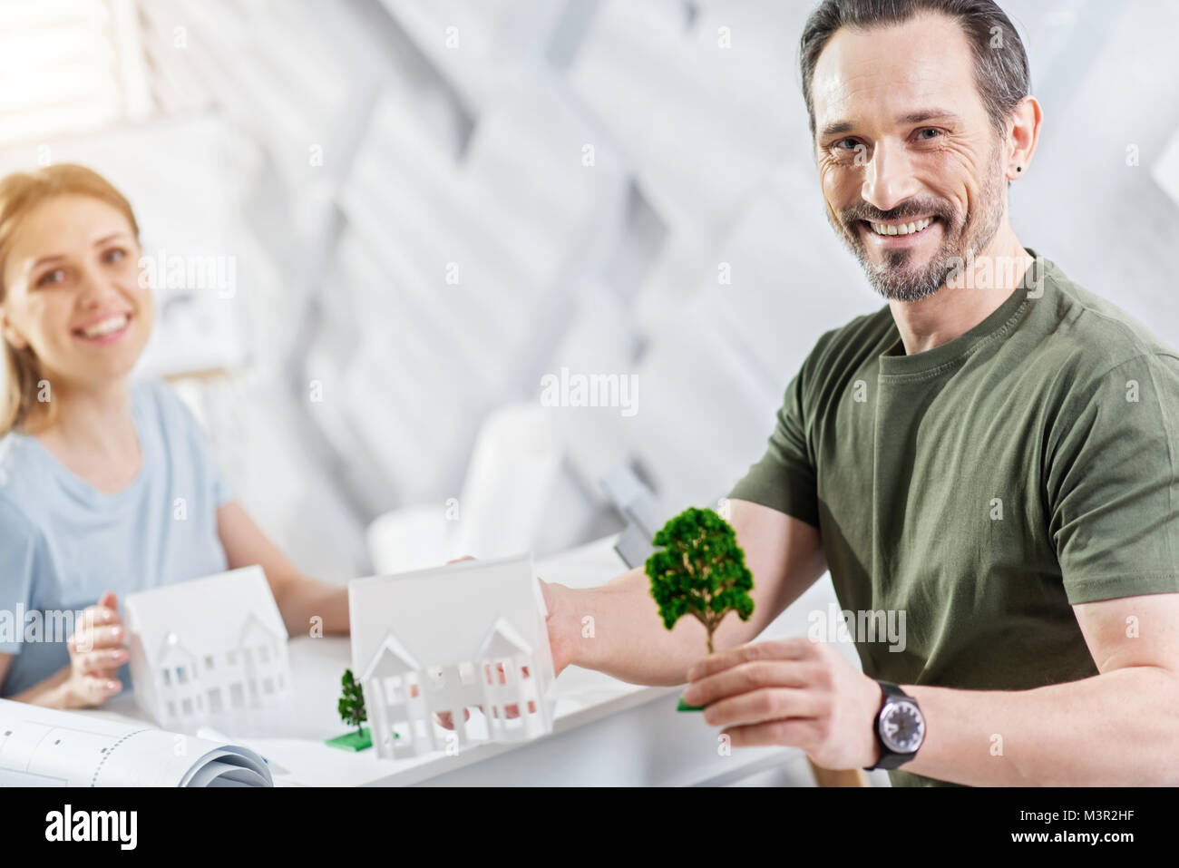 Gleeful ecologist working with his colleague - Stock Image