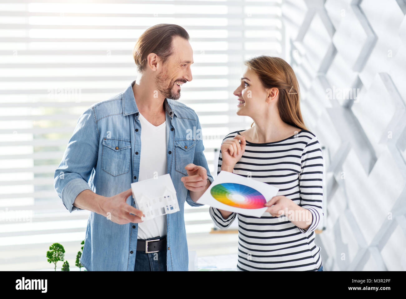 Inspired architects looking at each other - Stock Image