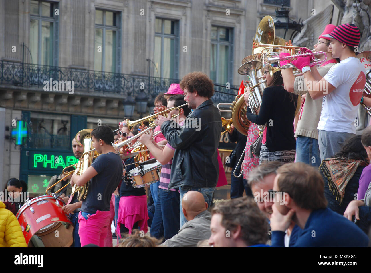 Street brass band performing in front of Palais Garnier (Opera House) in Paris, France - Stock Image