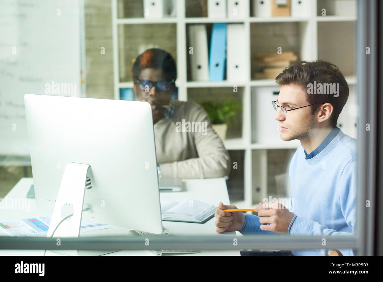 Team of IT Developers in Web Studio - Stock Image
