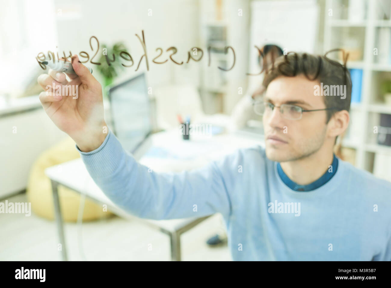 IT Professional Writing on Glass Wall - Stock Image