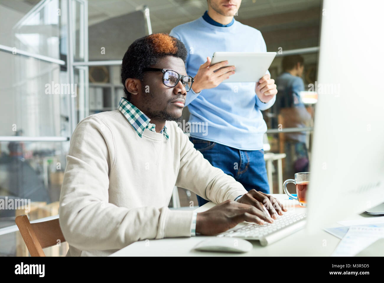 Two Web Developers Working on Code - Stock Image
