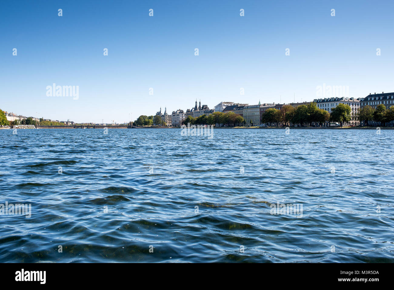 Peblinge Sø (lake) in Copenhagen as seen from the water with view towards Nørrebro - Stock Image