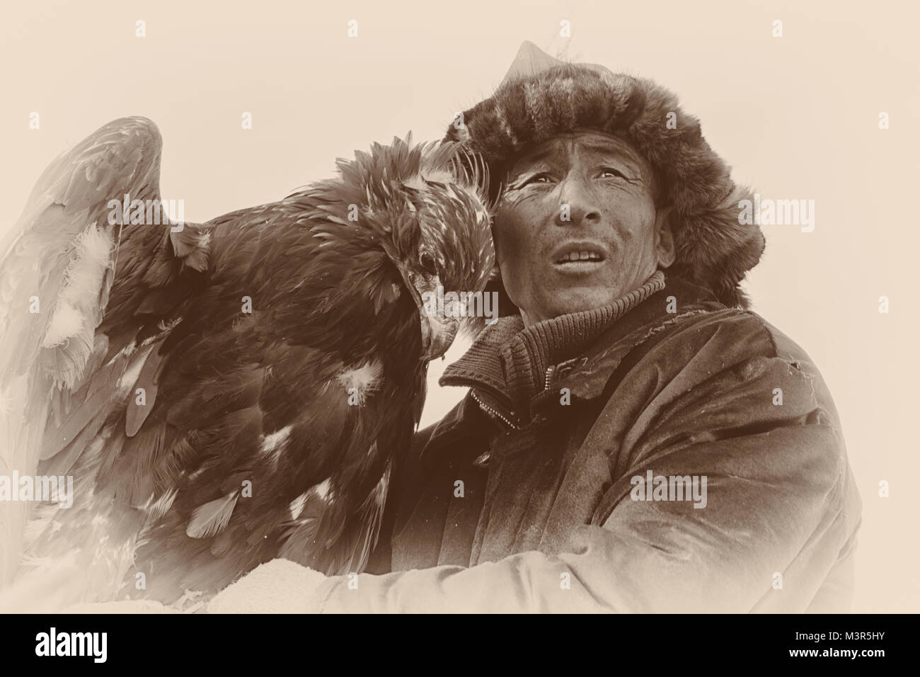 Golden eagle festival eagles and hunters huntress sepia series collection b&w portraits Ulgii Kazakh traditional Stock Photo