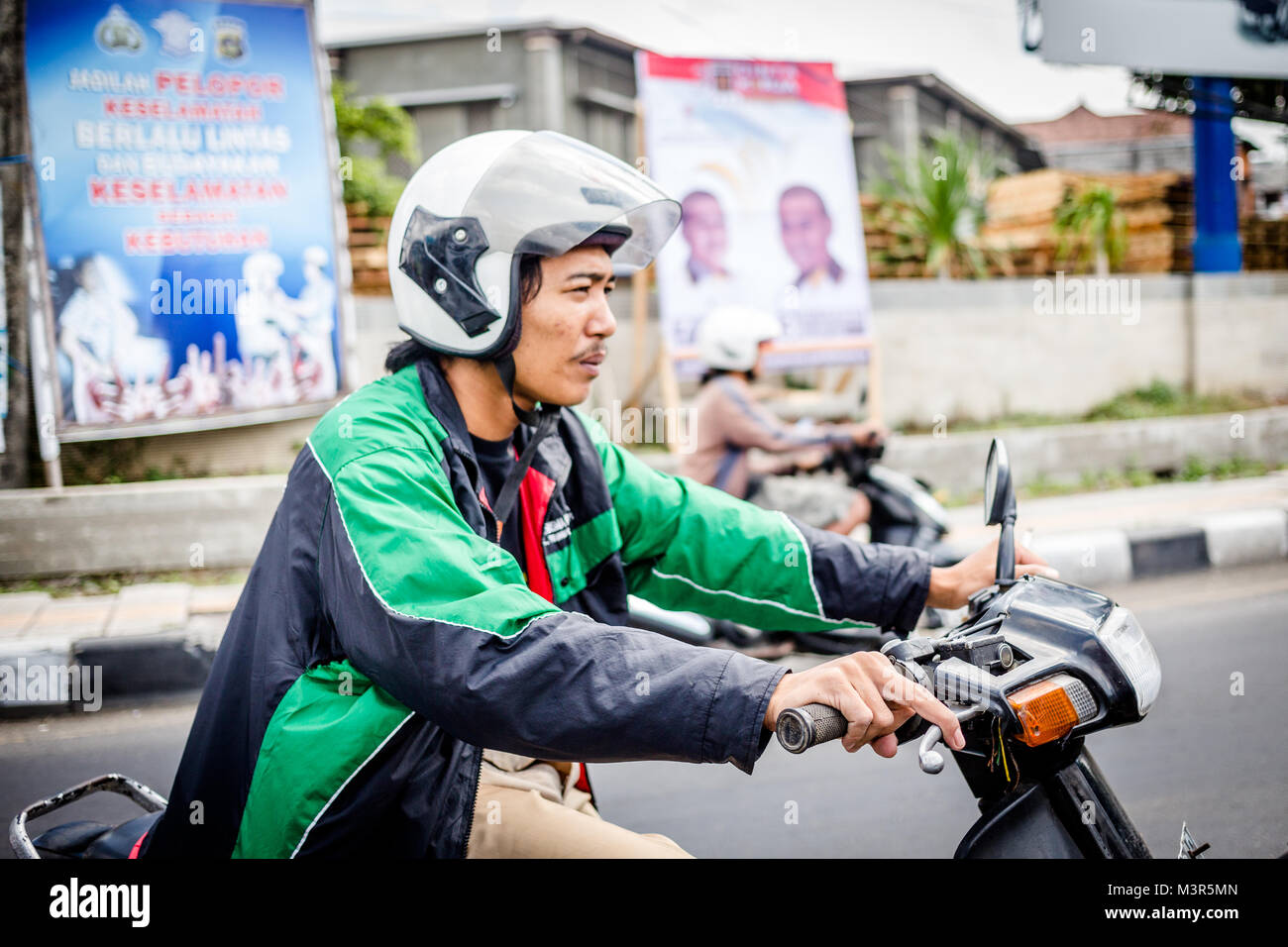 Bali, Indonesia, 28 August 2013: Traffic on streets of Bali Stock Photo