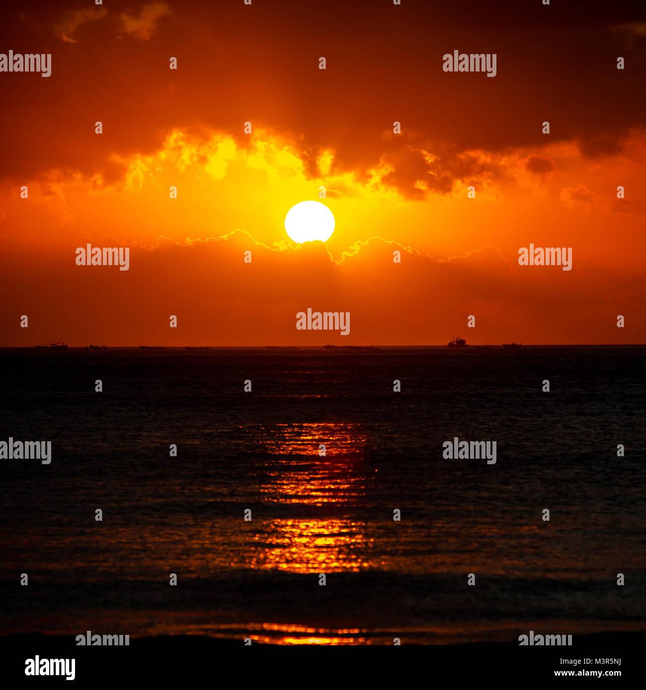 Sunset at Kuta Beach, Bali Indonesia Stock Photo