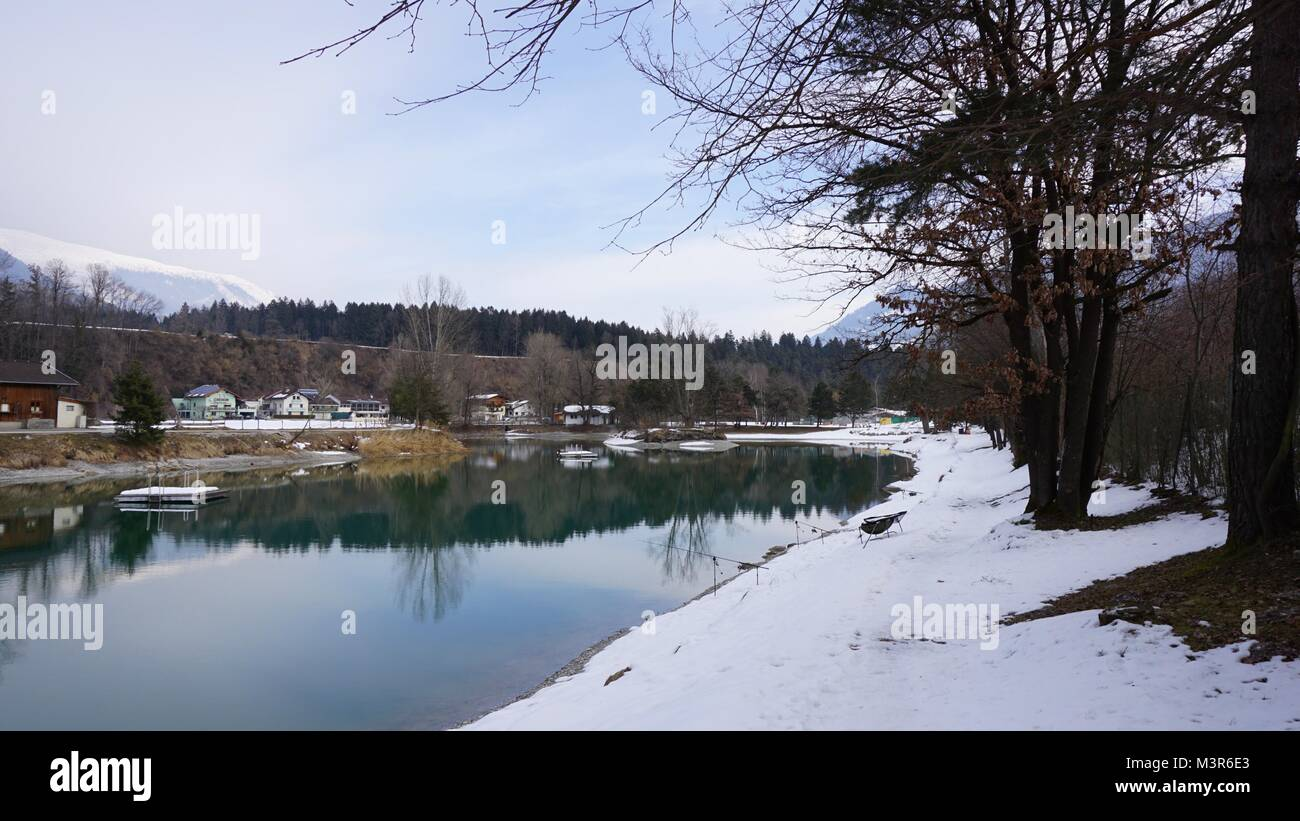 Terfens Tyrol Austria near Schwaz and Innsbruck - swimming and fishing lake Weisslahn in Winter - Stock Image