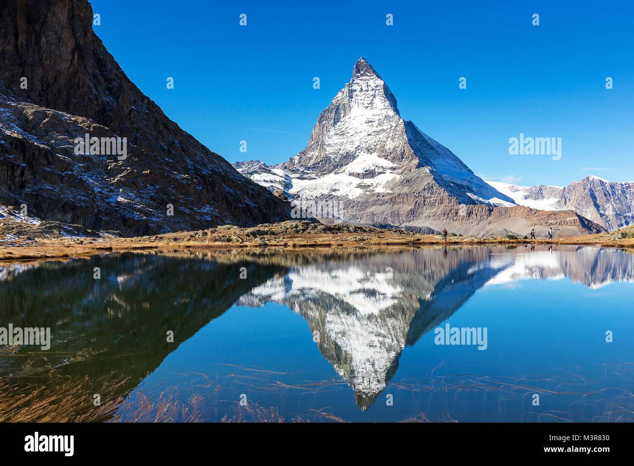 Matterhorn mountain view from Riffelsee lake, locate between Gornergrat train station, on high mountain in Zermatt, - Stock Image