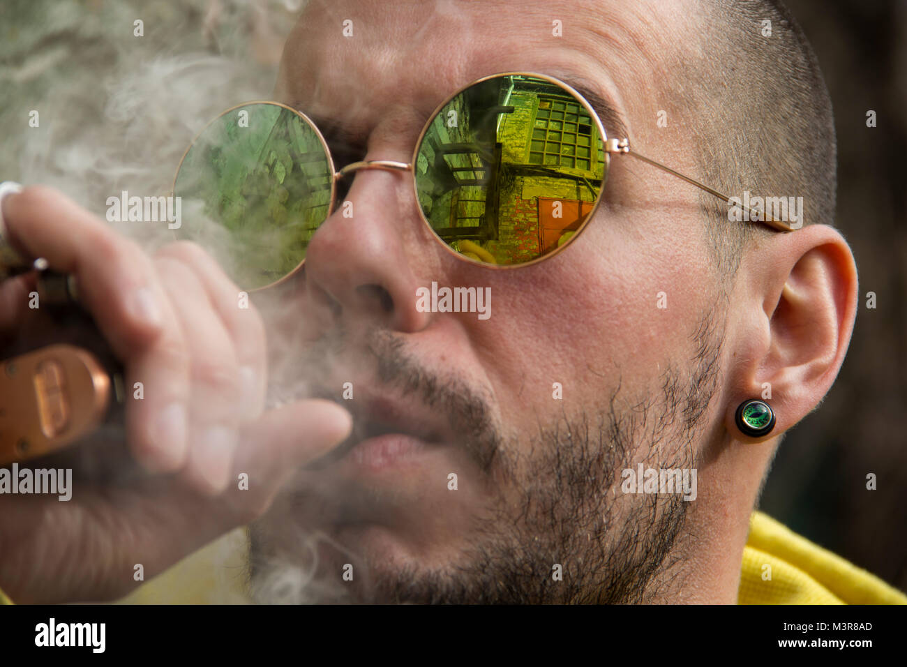 Portrait of a Vaper smoking an electronic cigarette - Stock Image