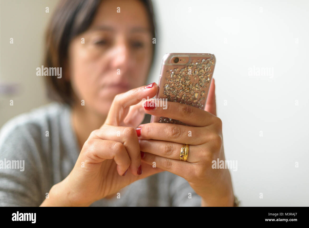 Woman on touch screen mobile phone - Stock Image